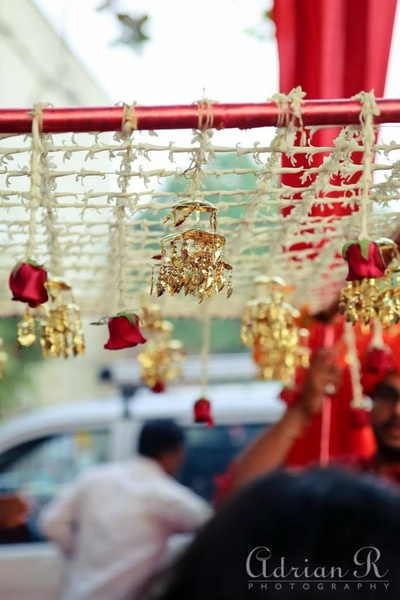 Bridal canopy made with Tube Roses and rose ends, festooned with gold decorations