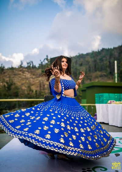 We are majorly crushing over this twirling bride and her gorgeous blue gottapatti lehenga.