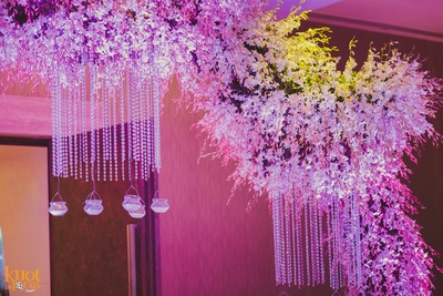 Reception venue decorated with LED lights , crystal strings and clustered floral arrangement