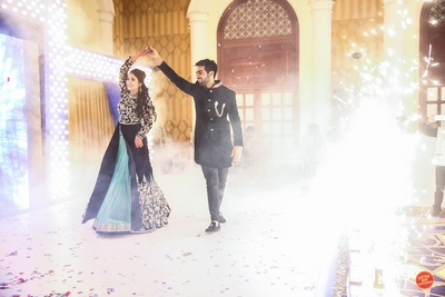 Bride and groom performing at their sangeet ceremony.