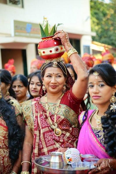 Elegant maroon and gold bandhej saree with green thick border