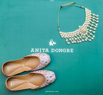 A shot of the bride's gorgeous juttis and jewellery before the wedding commenced.