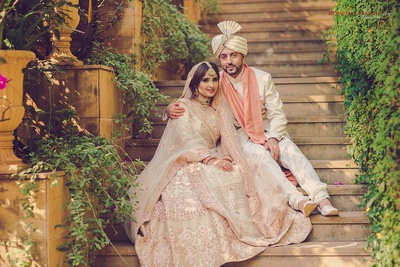 Bride and groom sit together during their post wedding photoshoot at Della Resorts, Lonavala
