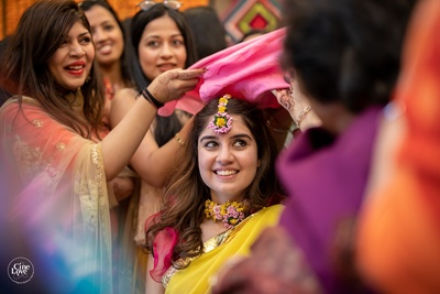 The bride is all smiles during her chudha ceremony.