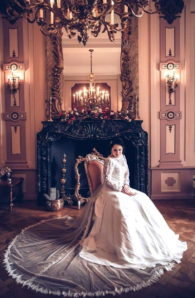 Royal bridal portrait of Kanika in her white net and lace wedding gown at Amsterdam, Netherlands