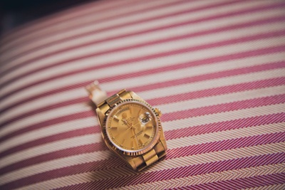 A gold classic Rolex for Neil Buddy Shah's classic Indian wedding