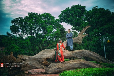 Dressed in ethnic Indian outfits for their outdoor pre wedding shoot