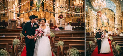 Church decorated with fairy lights, clustered floral arrangement and baby's breath assents