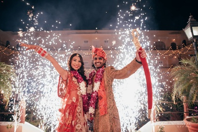 Fireworks, a gold sword and all smiles makes this wedding a super memorable affair