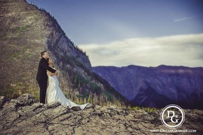 Romantic post wedding photo shoot in wedding outfits with white strapless gown and a black dapper suit