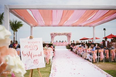 Gorgeous pink floral decor makes the wedding venue stand out!