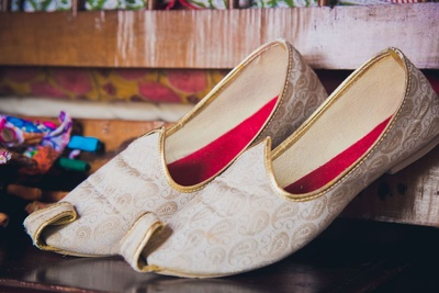 White and gold customized mojris with paisley weaves