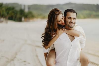 the couple posing romantically at the beach