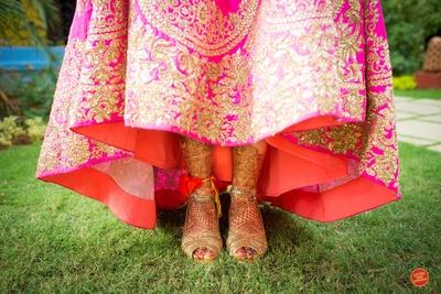 Pink lehenga is embellished with intricate zardozi border