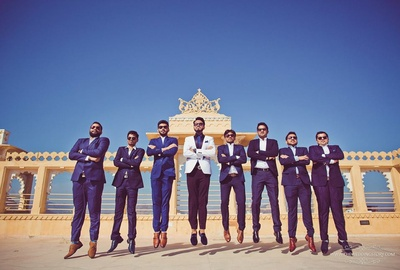 funky pre wedding photography pose of the groom and his groomsmen