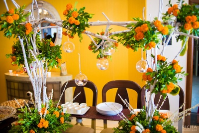 Gorgeous fresh Marigold decoration with tea-lights and and leaves