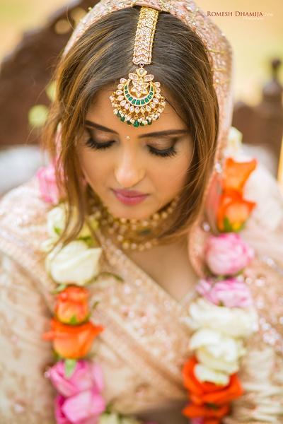 Close up shot of the bride at the wedding mandap