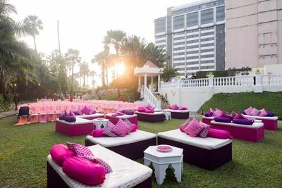 Fresh pastel hues and comfortable seating arrangement at the Bhajan Sandhya.
