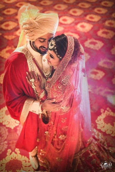 Top shot of the bride and groom in a candid wedding photography