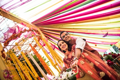 Dressed in complementing outfits for their outdoor mehendi ceremony held at Gold Palace, Jaipur