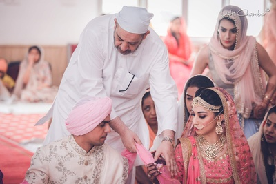 Wedding rituals performed by relatives at the wedding function at the GK1 gurudwara, Delhi