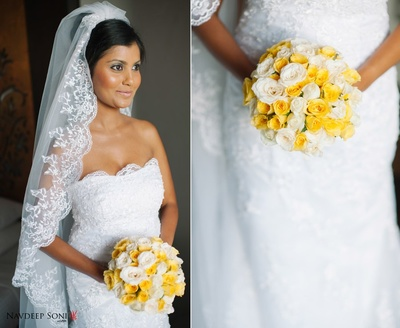 White strapless wedding dress with scalloped laced neckline and matching embroidered veil