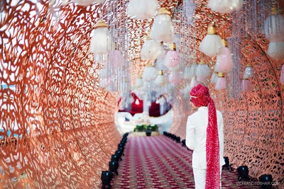 Extensive red bandhani Safa. Outfit ideas for groom