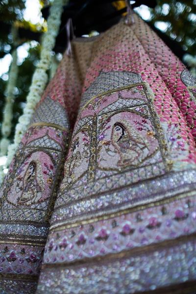 A close-up of the bride's beautiful lehenga.