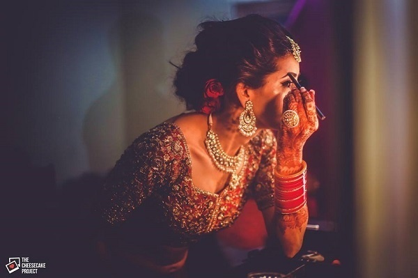7. While she puts the final touch to her makeup: