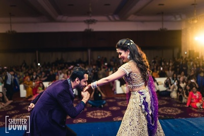 bride and groom dancing at the sangeet