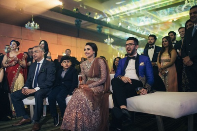 bride and groom having a gala time at their sangeet ceremony