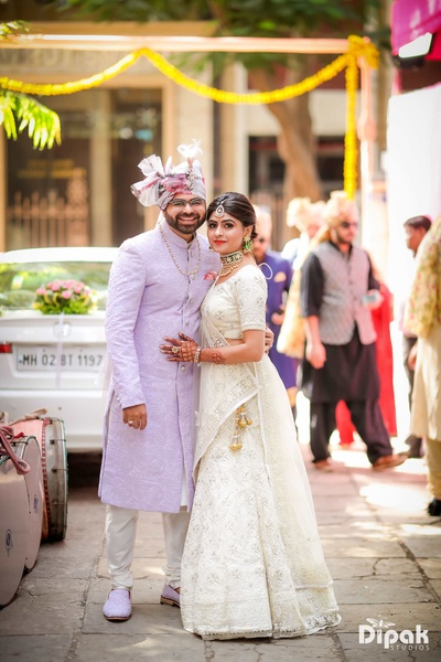 Groom posing along with his sister during the baraat