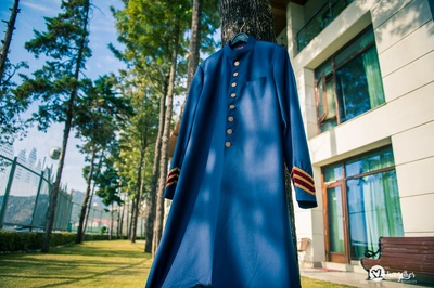 Groom's blue kurta outfit for the wedding ceremony
