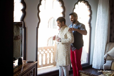 Layered embroidered jacket style sherwani with white resham embroidery for the wedding ceremony held at Hotel Fairmont, Jaipur