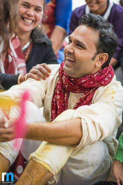 Off white kurta and churidaar styled with red bandhani dupatta