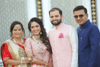 the couple with their family at the mehendi ceremony