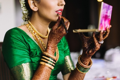Bride's hands covered with intricate bridal mehendi designs.