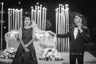 Black and white capture of the bride and groom during their sangeet ceremony