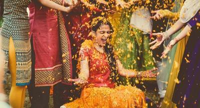 Flower rain for the bride on her haldi ceremony.