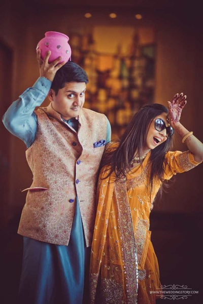Krutika and Akshay in a quirky pose for their pre wedding shot by The Wedding Story