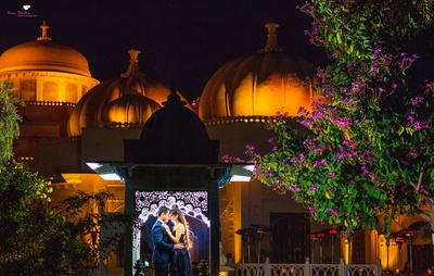 Evening pre wedding shot of a sweet romantic young couple in black formal outfits