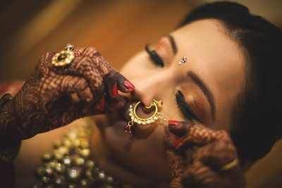 Hoop nose ring embedded with kundan stones