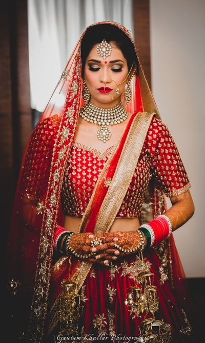 Looking absolutely stunning in this classic red and gold bridal lehenga along with bold and heavy kundan jewellery.