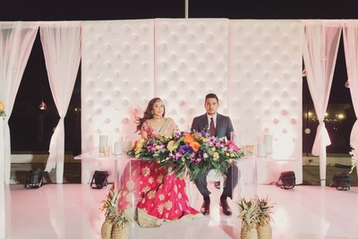 Bride and groom's table decorated with floral bouquets