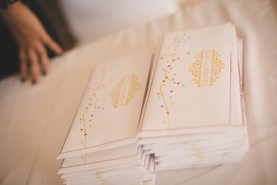 White and gold classy wedding invitation cards for Summet and Ekta's wedding