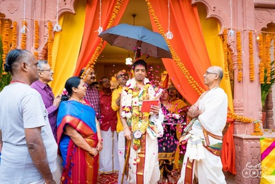 The groom walking towards the wedding mandap in traditional Tamil-style!
