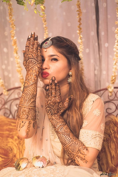 Quirky bridal pose for the mehndi ceremony
