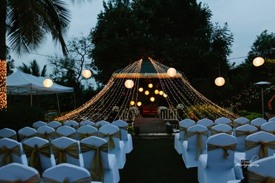 Fairy themed decor with fairy lights covering the stage.