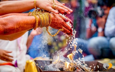 Henna covered arms, gold bangles and hathphool