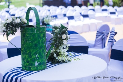 Painted watering can with real flowers, an outdoor decor prop